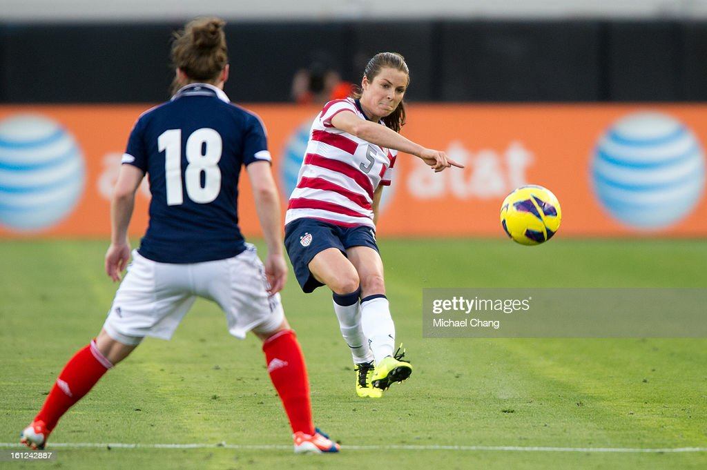 Defender <a gi-track='captionPersonalityLinkClicked' href=/galleries/search?phrase=Kelley+O%27Hara+-+Soccer+Player&family=editorial&specificpeople=4412490 ng-click='$event.stopPropagation()'>Kelley O'Hara</a> #5 of the United States passes the ball past forward Emma Mitchell #18 of Scotland at EverBank Field on February 9, 2013 in Jacksonville, Florida. The United States defeated Scotland 4-1.