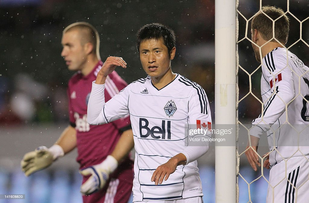Defender Lee YoungPyo of the Vancouver Whitecaps gets in position to defend the corner kick during the MLS match against Chivas USA at The Home Depot...