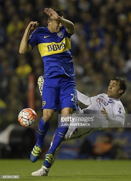 Defender Leonardo Jara of Argentina's Boca Juniors vies for the ball with Uruguay's Nacional defender Jorge Fucile during their Copa Libertadores...