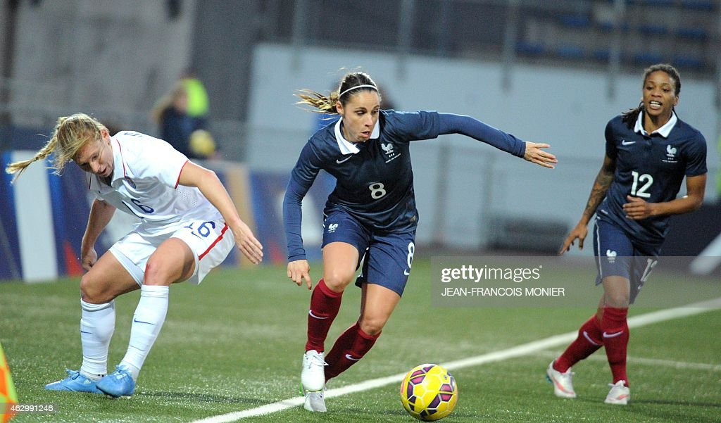 US' Defender Lori Chalupny (L) vies for the ball with France's defender <a gi-track='captionPersonalityLinkClicked' href=/galleries/search?phrase=Jessica+Houara&family=editorial&specificpeople=6380286 ng-click='$event.stopPropagation()'>Jessica Houara</a> (C) and France's midfielder <a gi-track='captionPersonalityLinkClicked' href=/galleries/search?phrase=Elodie+Thomis&family=editorial&specificpeople=813220 ng-click='$event.stopPropagation()'>Elodie Thomis</a> during the Women's friendly football match France vs USA on February 8, 2015, at the Moustoir Stadium, in Lorient, western France.