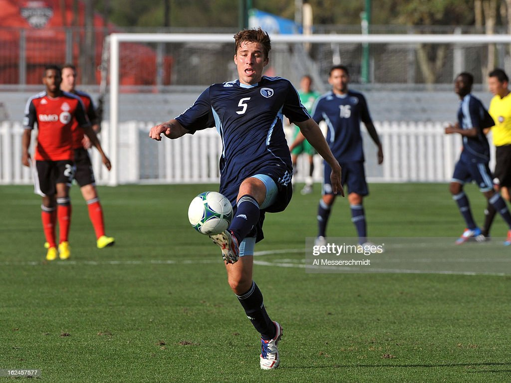 Defender Matt Besler #5 of Sporting Kansas City runs upfield against the Toronto FC in the final round of the Disney Pro Soccer Classic on February 23, 2013 at the ESPN Wide World of Sports Complex in Orlando, Florida.