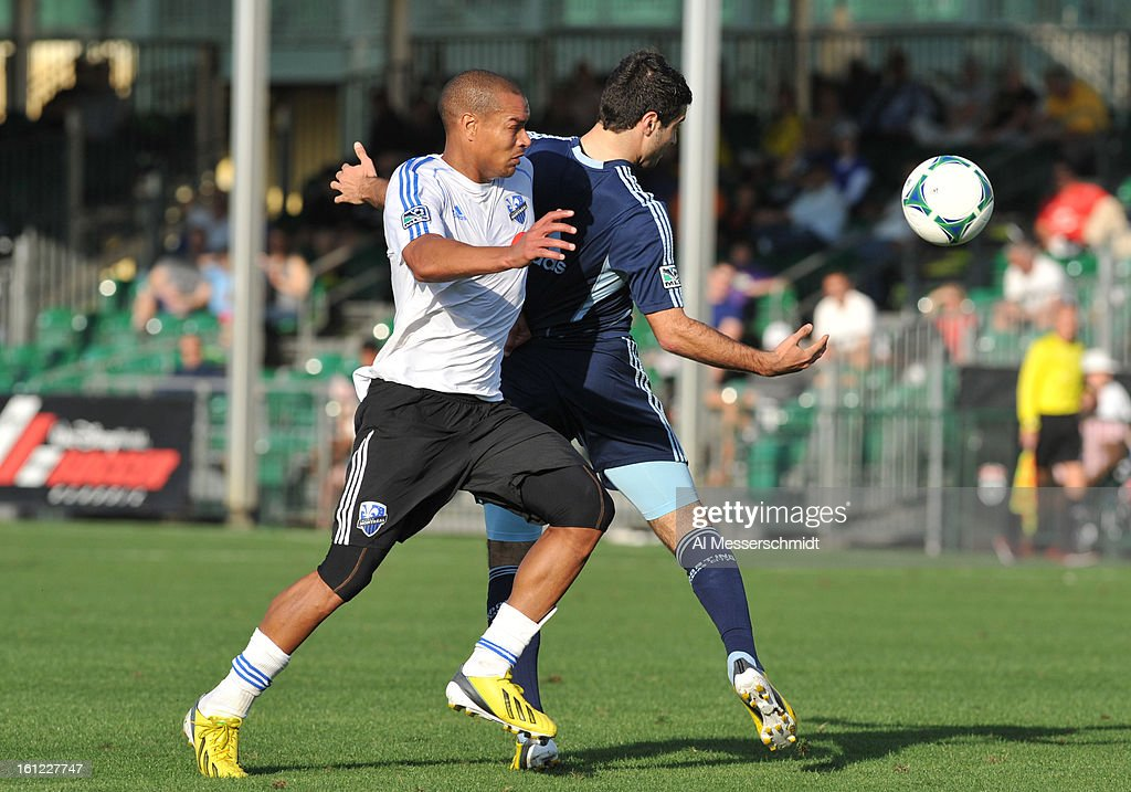 Defender Matteo Ferrari of the Montreal Impact battles for a ball against the Sporting Kansas City February 9 2013 in the first round of the Disney...