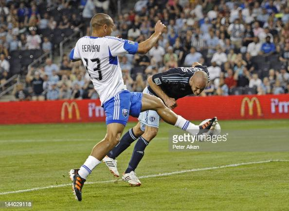 Defender Matteo Ferrari of the Montreal Impact blocks the shot of defender Aurelien Collin of Sporting Kansas City during the second half on May 5...