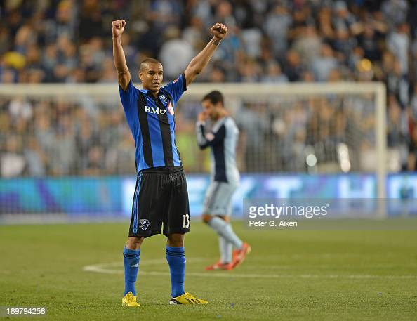 Defender Matteo Ferrari of the Montreal Impact celebrates after beating Sporting Kansas City on June 1 2013 at Sporting Park in Kansas City Kansas...