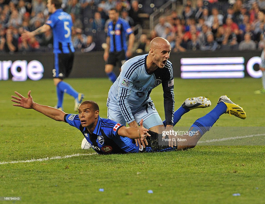 Defender Matteo Ferrari of the Montreal Impact reacts after a play against defender Aurelien Collin of Sporting Kansas City during the second half on...