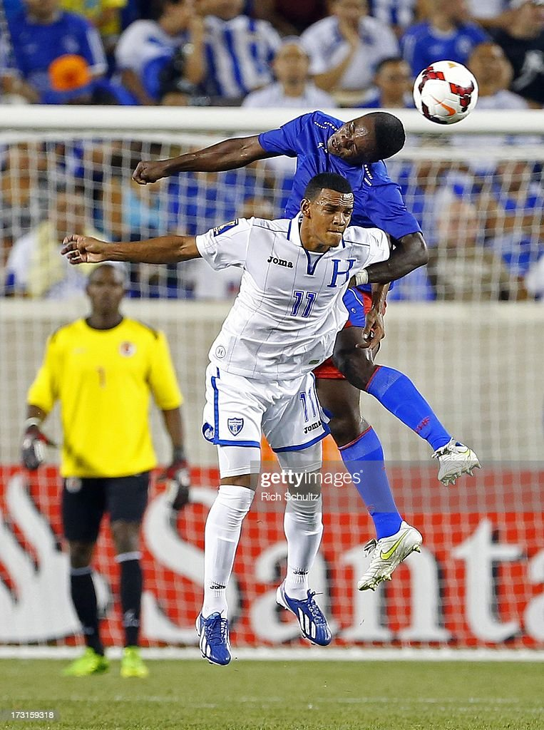 Defender Mechak Jerome #3 of Haiti heads the ball away from midfielder Rony Martinez #11 of Honduras during the first half of a 2013 CONCACAF Gold Cup soccer match on July 8, 2013 at Red Bull Arena in Harrison, New Jersey. Honduras defeated Haiti 2-0.