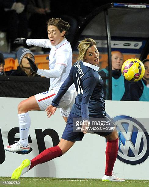 US' Defender Meghan Klingenberg vies for the ball with France's forward Claire Lavogez during the Women's friendly football match France vs USA on...