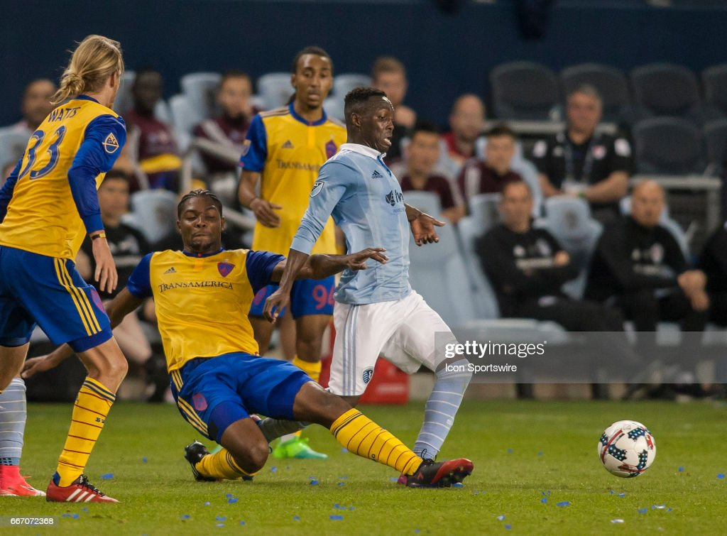 Defender Mekeil Williams (5) attempts to tackle the ball away from Forward Gerso Fernandes (7) during the MLS match between Sporting Kansas City and the Colorado Rapids. Sunday April 9th, 2017 at Children's Mercy Park in Kansas City, KS.