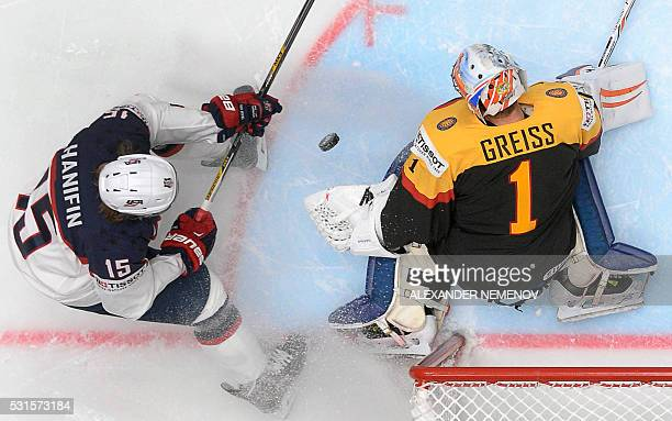 US defender Noah Hanifin attacks Germany's goalie Thomas Greiss vduring the group B preliminary round game Germany vs USA at the 2016 IIHF Ice Hockey...