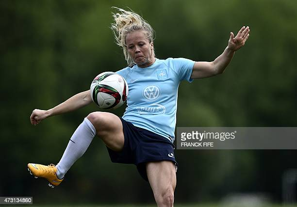 Defender of the French national women's football team Julie Soyer controls a ball during a training session in ClairefontaineenYvelines Suburban...