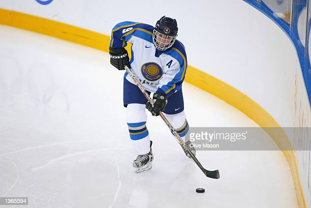 Defender Olga Potapova of Kazakhstan skates with the puck against China during their game at the Salt Lake City Olympic Winter Games on February 19...