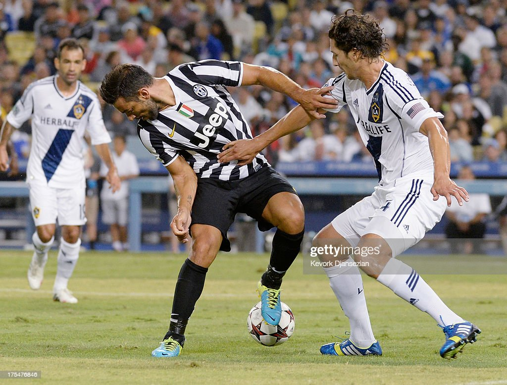 Defender Omar Gonzalez #4 of the Los Angeles Galaxy battles for the ball with Fabio Quagliarella #27 of Juventus during the first half of the 2013 Guinness International Champions Cup at Dodger Stadium on August 3, 2013 in Los Angeles, California