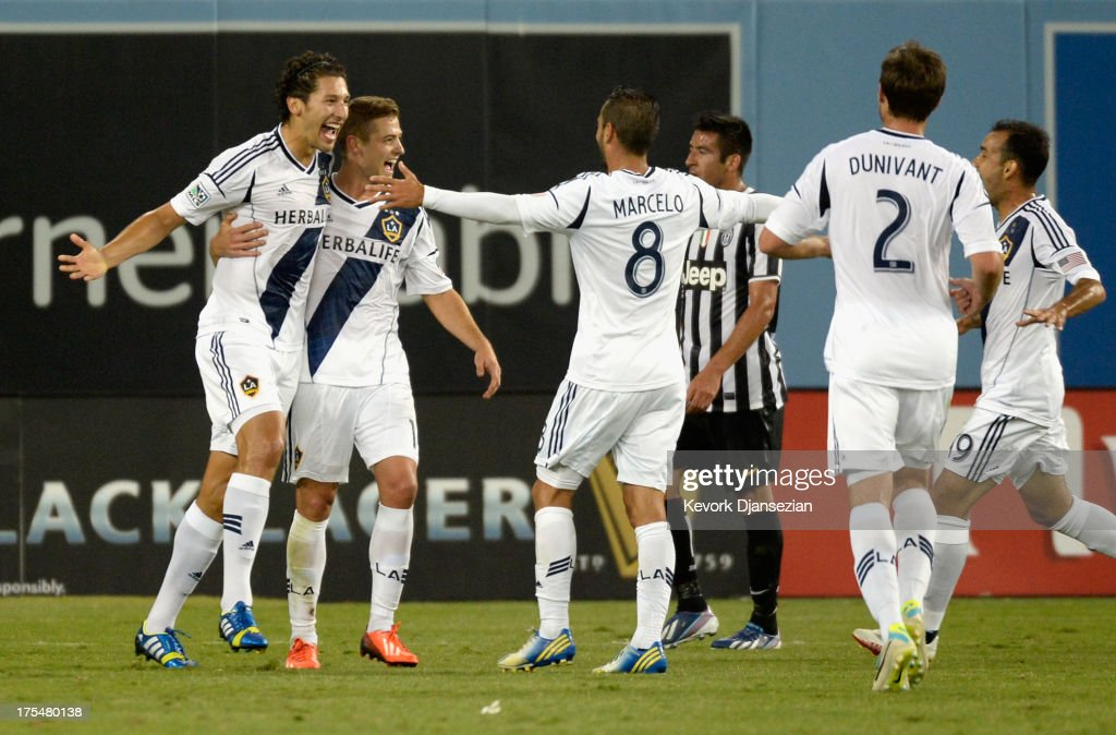 Defender Omar Gonzalez (L) of the Los Angeles Galaxy celebrates his goal against Juventus with teammates during the first half of the 2013 Guinness International Champions Cup at Dodger Stadium on August 3, 2013 in Los Angeles, California
