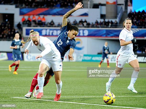 US' defender Rebecca Sauerbrunn vies for the ball with France's midfielder Elodie Thomis during the Women's friendly football match between France...