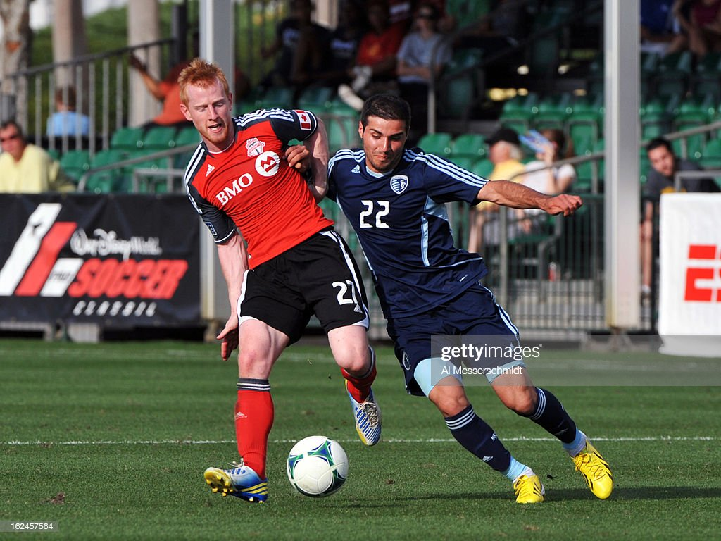 Defender <a gi-track='captionPersonalityLinkClicked' href=/galleries/search?phrase=Richard+Eckersley&family=editorial&specificpeople=4192571 ng-click='$event.stopPropagation()'>Richard Eckersley</a> #27 of Toronto FC battles forward Soony Saad #22 of Sporting Kansas City in the final round of the Disney Pro Soccer Classic on February 23, 2013 at the ESPN Wide World of Sports Complex in Orlando, Florida.