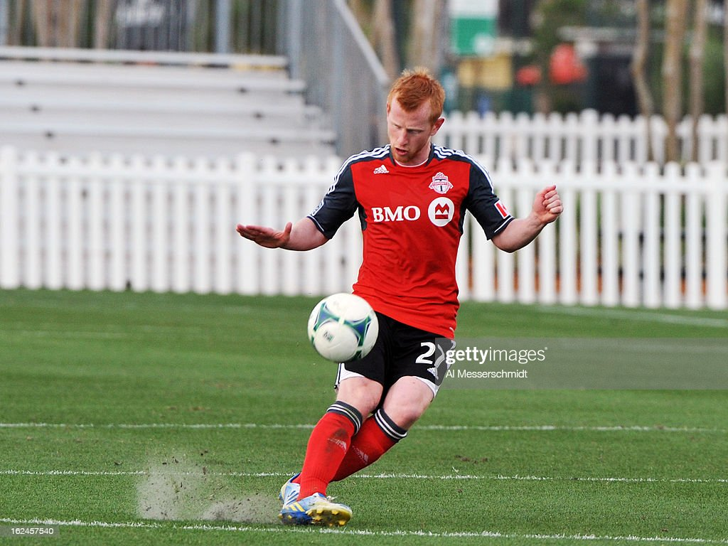 Defender <a gi-track='captionPersonalityLinkClicked' href=/galleries/search?phrase=Richard+Eckersley&family=editorial&specificpeople=4192571 ng-click='$event.stopPropagation()'>Richard Eckersley</a> #27 of Toronto FC passes upfield against Sporting Kansas City in the final round of the Disney Pro Soccer Classic on February 23, 2013 at the ESPN Wide World of Sports Complex in Orlando, Florida.