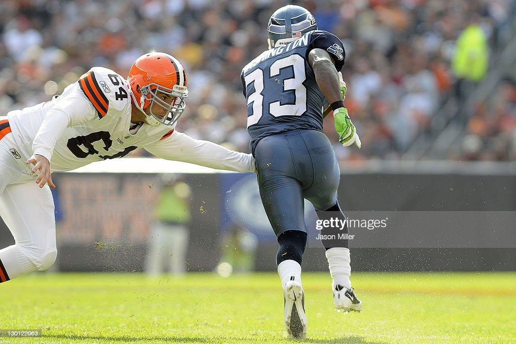 Defender Ryan Pontbriand of the Cleveland Browns misses running back Leon Washington of the Seattle Seahawks on a kickoff return during the third...