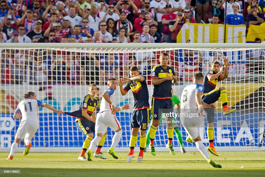 Defender <a gi-track='captionPersonalityLinkClicked' href=/galleries/search?phrase=Santiago+Arias&family=editorial&specificpeople=6506898 ng-click='$event.stopPropagation()'>Santiago Arias</a> #4, midfielder <a gi-track='captionPersonalityLinkClicked' href=/galleries/search?phrase=James+Rodriguez&family=editorial&specificpeople=4422074 ng-click='$event.stopPropagation()'>James Rodriguez</a> #10, midfielder <a gi-track='captionPersonalityLinkClicked' href=/galleries/search?phrase=Edwin+Cardona&family=editorial&specificpeople=7441342 ng-click='$event.stopPropagation()'>Edwin Cardona</a> #8, and midfielder Sebastian Perez #13 of Colombia defend against a kick by forward Clint Dempsey #8 of the United States during a group A match between the United States and Colombia at Levi's Stadium as part of Copa America Centenario US 2016 on June 03, 2016 in Santa Clara, California, US. Colombia won 2-0.