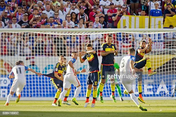 Defender Santiago Arias midfielder James Rodriguez midfielder Edwin Cardona and midfielder Sebastian Perez of Colombia defend against a kick by...