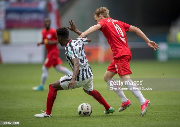 Defender Taleb Tawatha of Eintracht Frankfurt interfered by Forward Emil Forsberg of RB Leipzig at the Commerzbank Arena during the 1 Bundesliga...