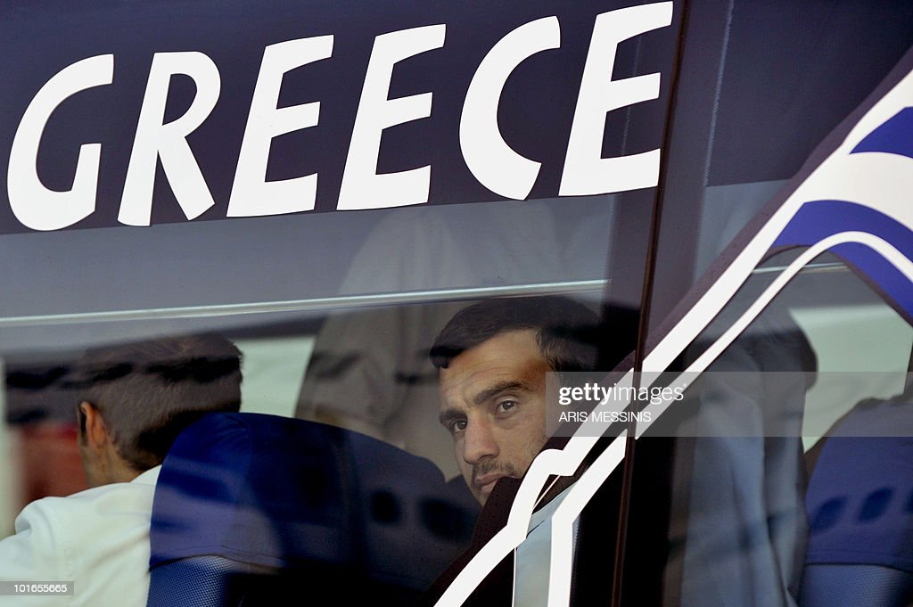 Defender Vasilis Torosidis looks out from the bus window after Greece's national football team arrived at the King Shaka international airport in Durban on June 6, 2010 four days before the opening of the 2010 World Cup football tournament. The World Cup will take place in South Africa from June 11 to July 11, the first time on African soil for the biggest and most prestigious competition in sport. AFP PHOTO / Aris Messinis