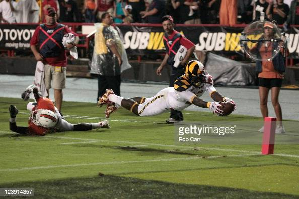 Defender Vaughn Telemaque of the Miami Hurricanes misses the tackle as Ronnie Tyler of the Maryland Terrapins scores a touchdown during the first...