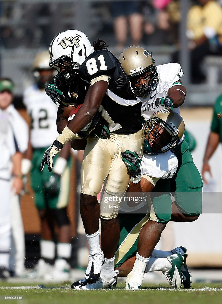 Defenders Calvin Jones #11 and Darius Powell #13 of the Alabama Birmingham Blazers tackle receiver Breshad Perriman #81 of the Central Florida Knights during the game at Bright House Networks Stadium on November 24, 2012 in Orlando, Florida.