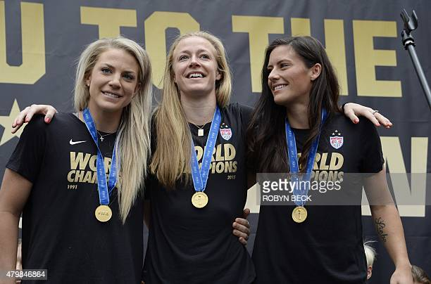US defenders Julie Johnston Becky Sauerbrunn and Ali Krieger attend the US Women's World Cup football team's championship rally at LA LIVE in...