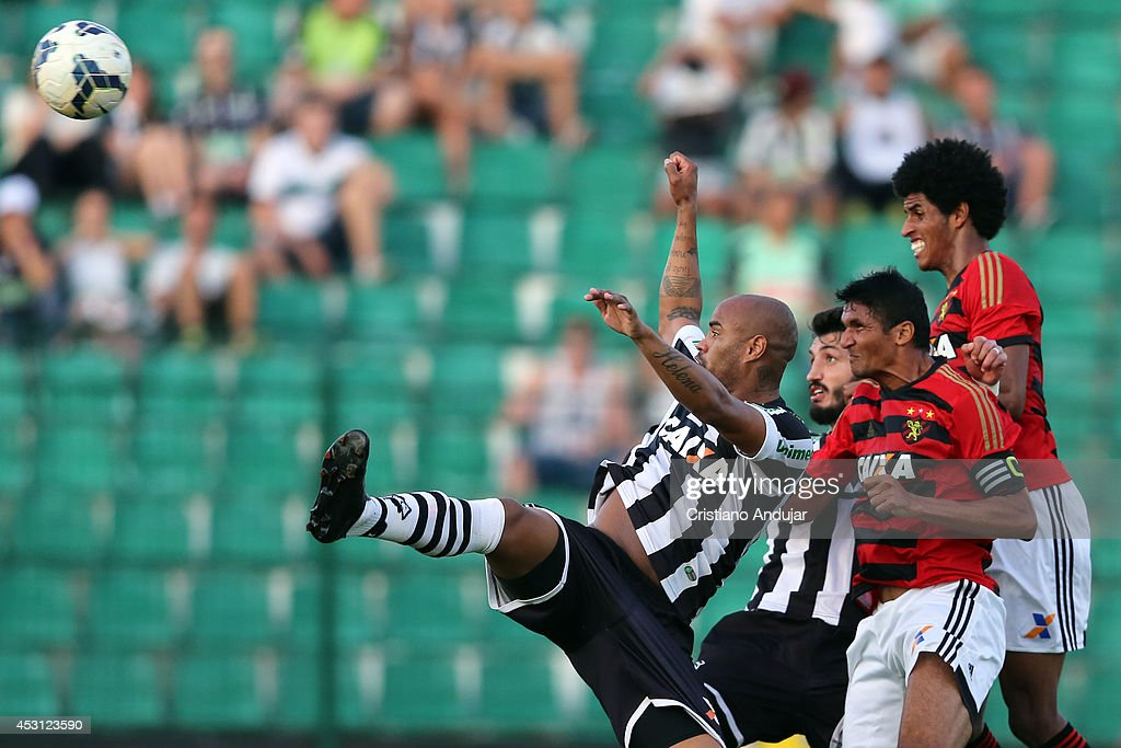 Defenders jumps to header after corner during a match between Figueirense and Sport as part of Campeonato Brasileiro 2014 at Orlando Scarpelli Stadium on August 3, 2014 in Florianopolis, Brazil