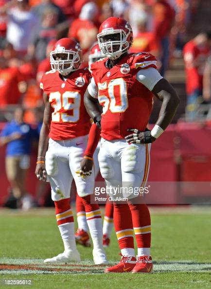 Defenders Justin Houston and Eric Berry of the Kansas City Chiefs look on against the New York Giants during the second half on September 29 2013 at...