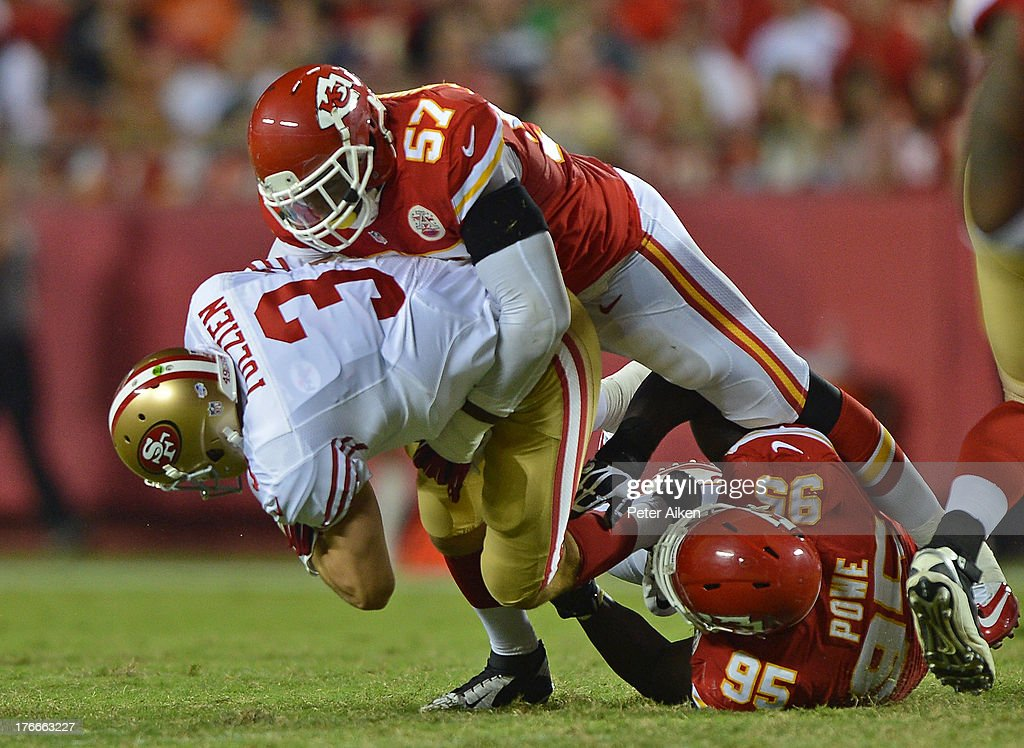 Defenders Nico Johnson #57 and Jerrell Powe #95 of the Kansas City Chiefs sack quarterback <a gi-track='captionPersonalityLinkClicked' href=/galleries/search?phrase=Scott+Tolzien&family=editorial&specificpeople=5649767 ng-click='$event.stopPropagation()'>Scott Tolzien</a> #3 of the San Francisco 49ers during the second half on August 16, 2013 at Arrowhead Stadium in Kansas City, Missouri. The 49ers won 15-13.