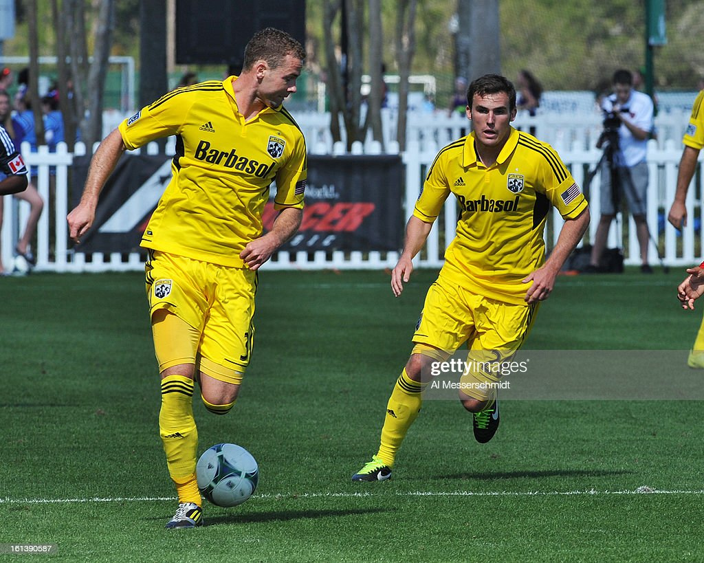 Defenders Reed Matte #26 and Josh Williams #3 of the Columbus Crew run upfield during play against Toronto FC February 9, 2013 in the first round of the Disney Pro Soccer Classic in Orlando, Florida. Columbus won 1 - 0.