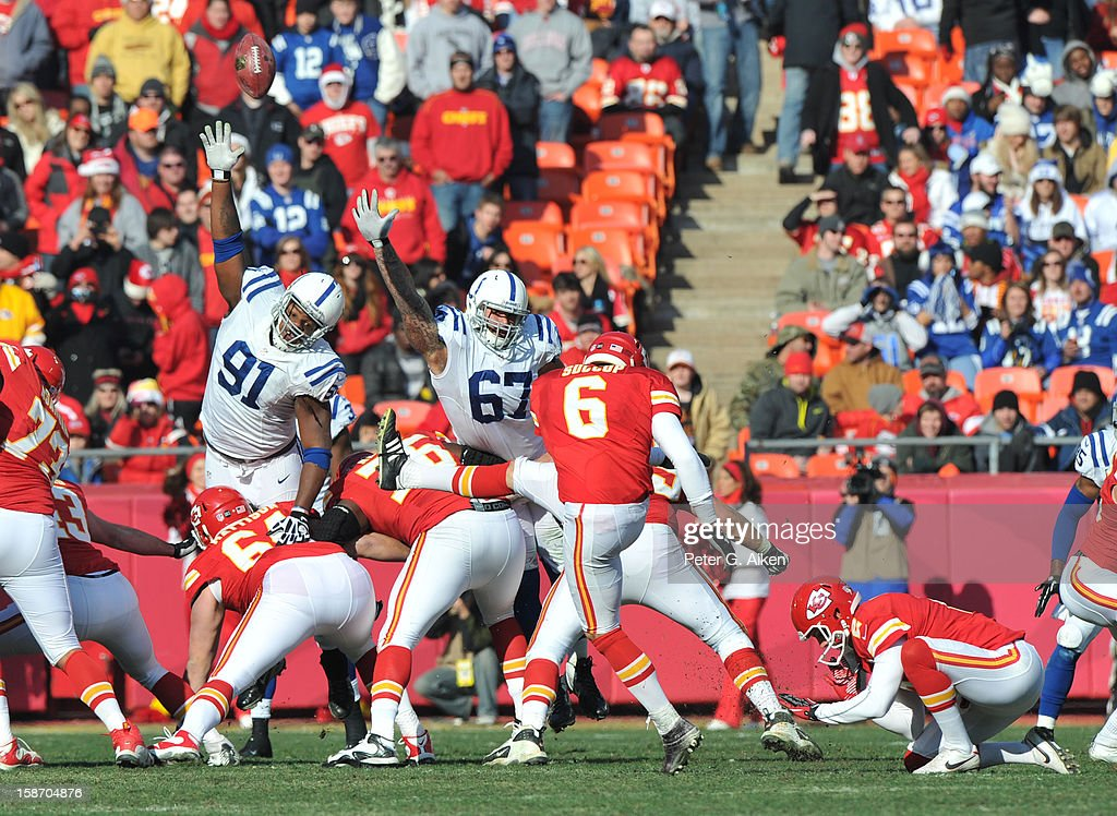 Defenders Ricardo Mathews and Lawrence Guy of the Indianapolis Colts attempts to block a field goal try by place kicker Ryan Succop of the Kansas...