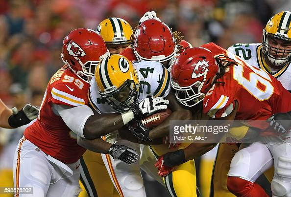 Defenders Terrance Smith and Rakeem NunezRoches of the Kansas City Chiefs tackle running back Brandon Burks of the Green Bay Packers during the first...