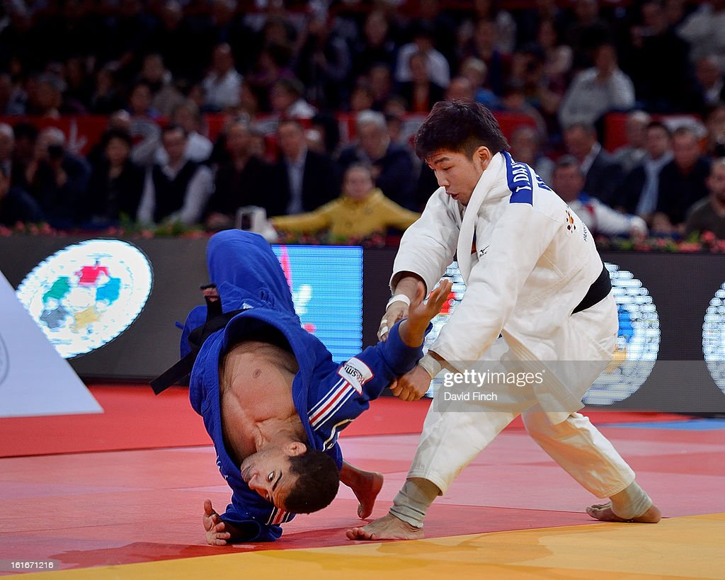 Defending champion and eventual gold medallist, David Larose of France (blue), managed to avoid conceding a score when he completely turned onto his front in response to a foot-sweep by Tumurkhuleg Davaadorj of Mongolia. Larose then won the u66kgs final by ippon to take his second successive gold medal during the Paris Grand Slam on day 1, Saturday, February 09, 2013 at the Palais Omnisports de Paris, Bercy, Paris, France.