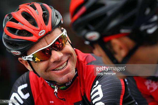 Defending champion Cadel Evans of Australia riding for BMC Racing chats with teammate George Hincapie of the USA before commencing a training ride in...