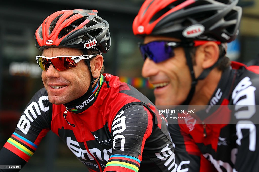 Defending champion Cadel Evans of Australia riding for BMC Racing chats with teammate George Hincapie of the USA before commencing a training ride in preparation for the 2012 Tour de France on June 29, 2012 in Liege, Belgium.