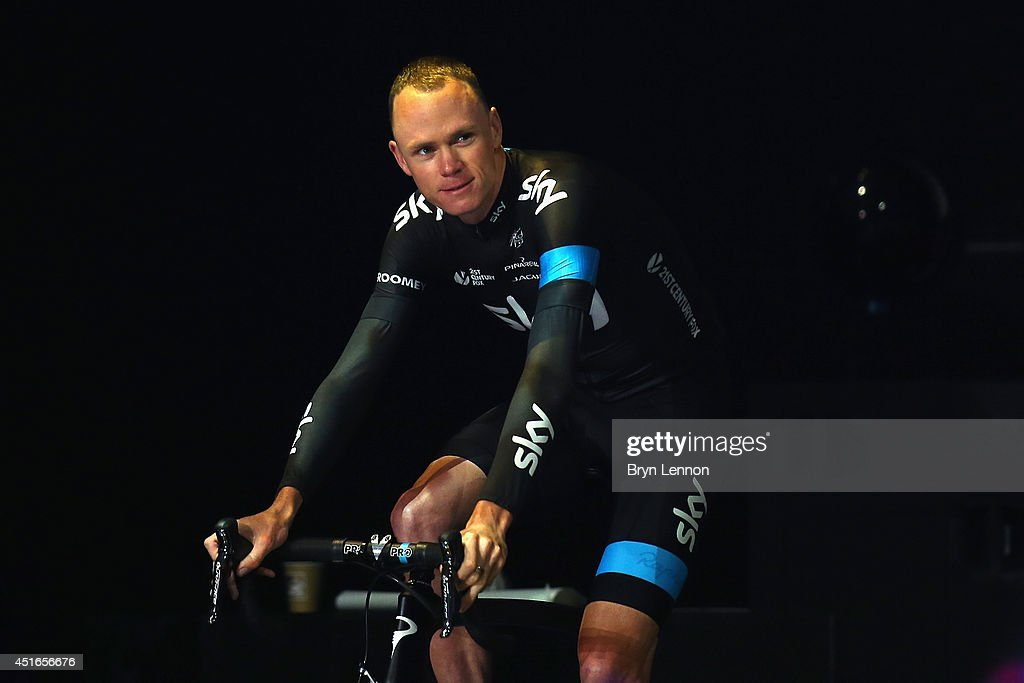 Defending Champion <a gi-track='captionPersonalityLinkClicked' href=/galleries/search?phrase=Chris+Froome&family=editorial&specificpeople=5428054 ng-click='$event.stopPropagation()'>Chris Froome</a> of Great Britain and Team SKY rides onto the stage during the 2014 Tour de France Team Presentation prior to the 2014 Le Tour de France Grand Depart on July 3, 2014 in Leeds, United Kingdom.