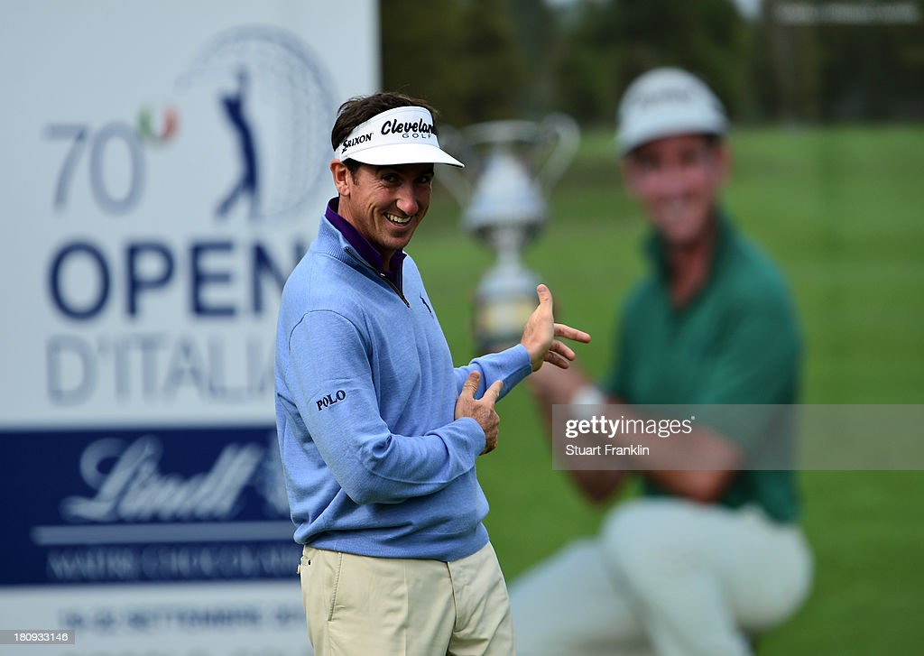 Defending champion Gonzalo Fernandez Castano of Spain point to a poster of himself with the trophy during the pro-am prior to the start of the Italian Open golf at Circolo Golf Torino on September 18, 2013 in Turin, Italy.