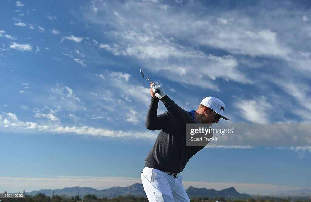 Defending champion <a gi-track='captionPersonalityLinkClicked' href=/galleries/search?phrase=Hunter+Mahan&family=editorial&specificpeople=885292 ng-click='$event.stopPropagation()'>Hunter Mahan</a> of USA plays a shot during practice prior to the start of the World Golf Championships-Accenture Match Play Championship at the Ritz-Carlton Golf Club on February 19, 2013 in Marana, Arizona.