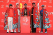 Defending champion Ian Poulter of England poses on stage with Jason Dufner of the USA Justin Rose of England Phil Mickelson of the USA and Rory...