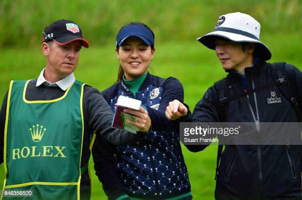 Defending Champion In Gee Chun of South Korea looks happy with her caddie and coach during the pro am prior to the start of The Evian Championship at...