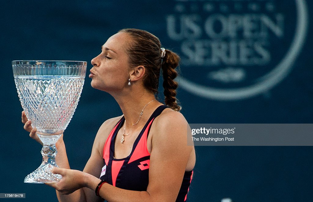 Defending champion Magdalena Rybarikova puckers up to kiss the trophy as she defeated Andrea Petkovic 6-4, 7-6 winning her second title in a row at the Citi Open at the Fitzgerald Tennis Center Sunday August 4, 2013 in Washington, DC.