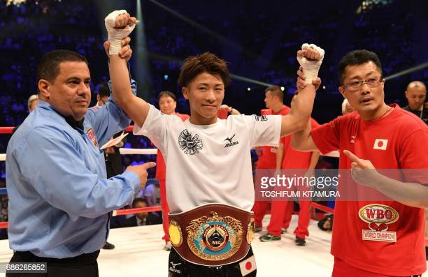 Defending champion Naoya Inoue of Japan poses after his victory over challenger Ricardo Rodriguez of the US in their WBO junior bantamweight title...
