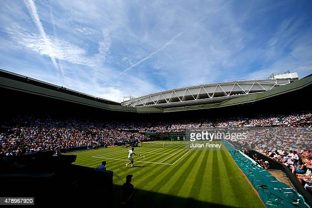 Defending champion Novak Djokovic of Serbia in action in his Gentlemen's Singles first round match against Philipp Kohlschreiber of Germany during...