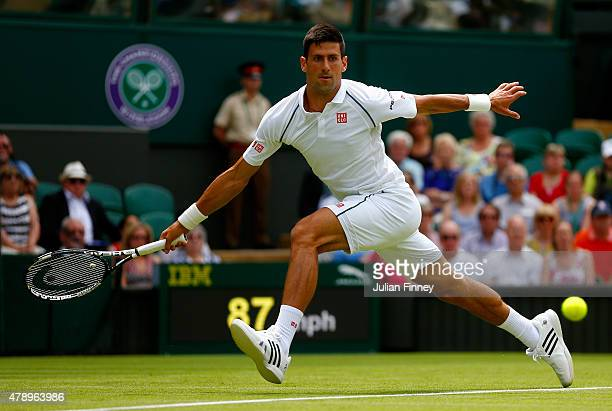 Defending champion Novak Djokovic of Serbia stretches for a forehand in his Gentlemen's Singles first round match against Philipp Kohlschreiber of...