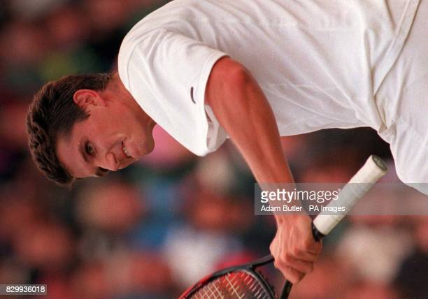 Defending champion Richard Krajicek looks angrily over his shoulder during his match against Tim Henman on Centre Court this evening Henman was two...