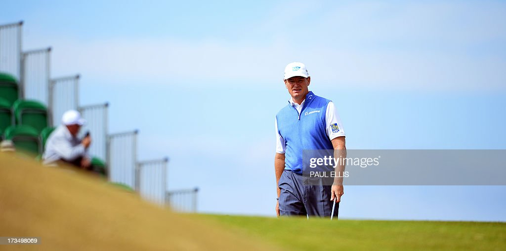 Defending champion, South Africa's Ernie Els waks to the eighth tee at Muirfield golf course at Gullane in Scotland on July 15, 2013 ahead of The 2013 Open Golf Championship. AFP PHOTO/PAUL ELLIS