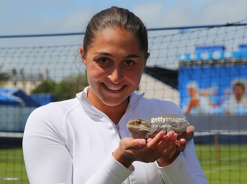 Defending Champion Tamira Paszek of Austria poses for a photo with a Bearded Dragon during day one of the Aegon International at Devonshire Park on June 15, 2013 in Eastbourne, England.