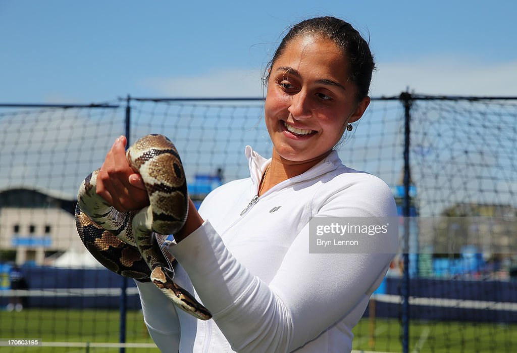Defending Champion Tamira Paszek of Austria poses for a photo with a Royal Python during day one of the Aegon International at Devonshire Park on June 15, 2013 in Eastbourne, England.